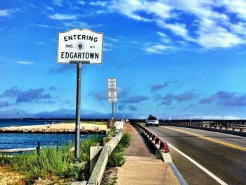 sign on side of bridge saying