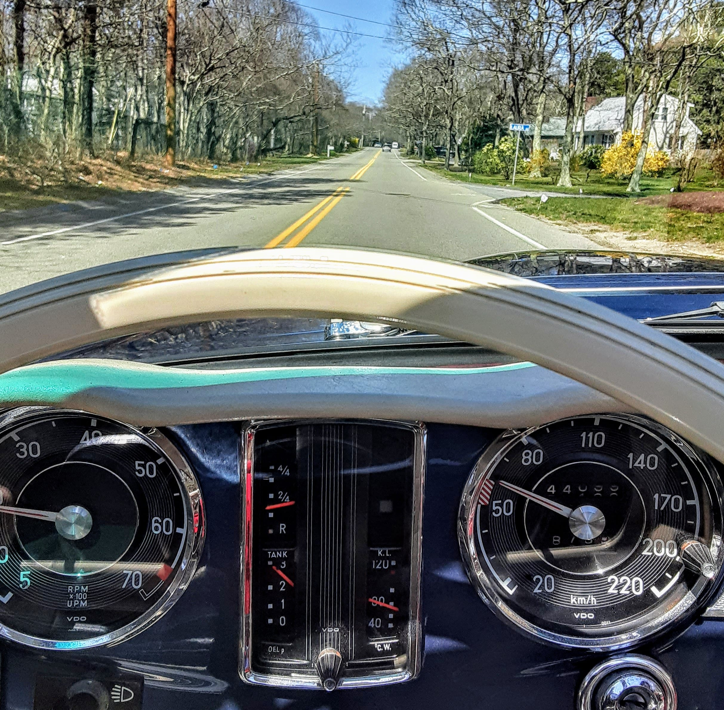 A vintage car drives down 6A