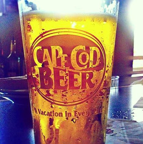 A frosty pint of Cape Cod beer sits on a bar