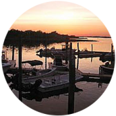 The old harbor village at sunset with glassy water