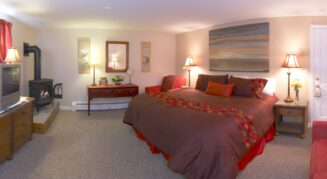 Lair 4 with red sheets on the bed and a nice gas fireplace for warmth