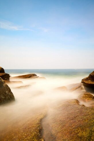 The ocean breaks through the rocks