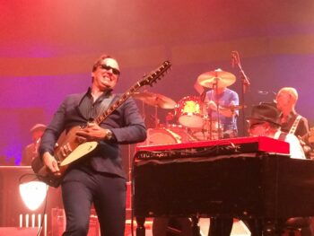 Joe Bonamassa playing guiter at the Melody Tent