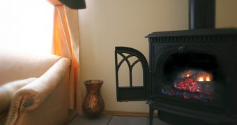 A lit gas fireplace stove