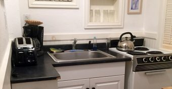 The white and black kitchenette of Lambs Retreat