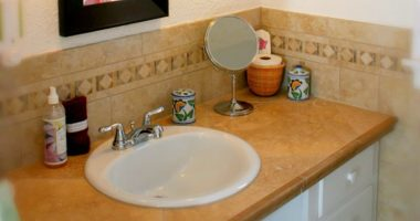 Sink with bath amenities and mirror