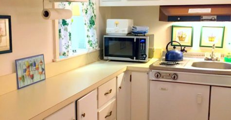 a white and yellow kitchenette