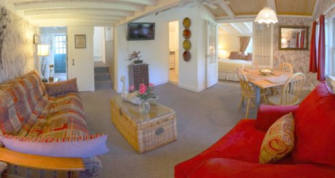 Lamb's Retreat suite with red sofa