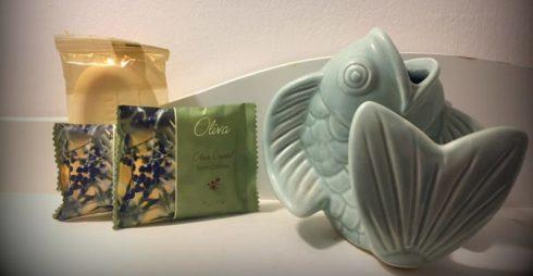 A miniature fish statue in a guest bath