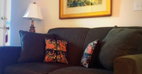 The couch under a nice framed painting