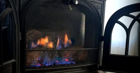 The fireplace is turned on