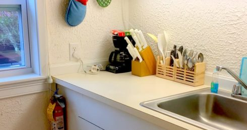 Kitchen of Sweet 9 showing sink and utensils