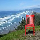 Red chair overlooking body of water